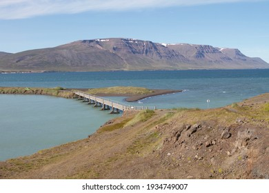 Small bridge connecting a small island in Iceland