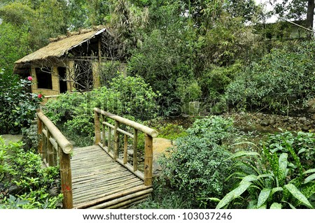 Small Bridge And Hut In A Garden