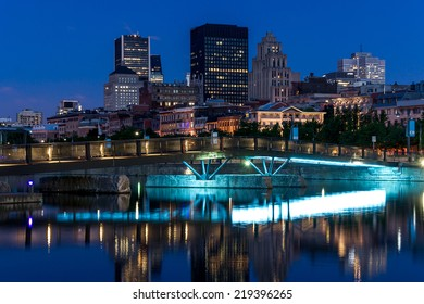 Small Bridge for Pedestrians with Basin Water, and in the background a part of the City of Montreal with a bit of digital noise.