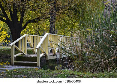 Small bridge under the trees in the city park