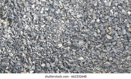 Small broken pebbles spread on the floor.