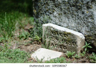 small broken tombstone - landscape