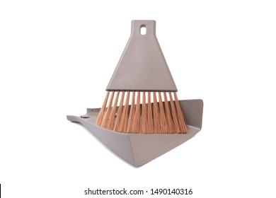 Small broom and dustpan household cleaning set isolated on white background.