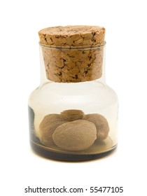 small brown glass bottle with nutmeg inside, isolated on white