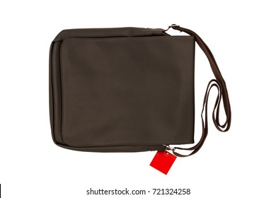 Small brown leather bag or shoulder bag with tag price for man isolated on white background. Lifestyle and fashion concept.  File including clipping path.