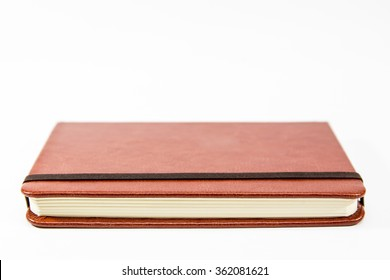 Small brown notebook isolated in white background.