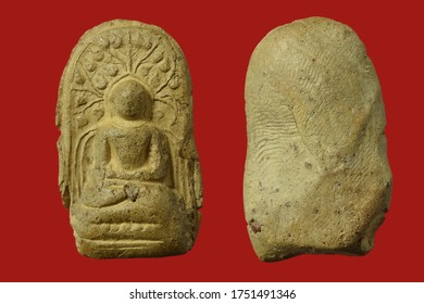 Small Buddha image or sacred Amulet of thailand, on red background