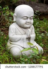 Small Buddha statue in a garden
