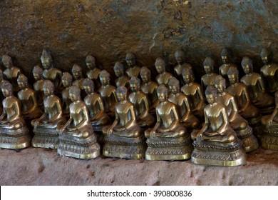 Small Buddha statues  in a shrine at  Phnom Kulen, Cambodia