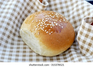 small bun with sesame seeds. Grain mill products. Bread.