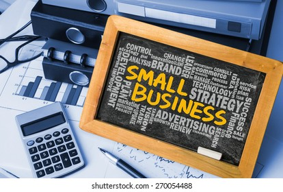 small business concept with related word cloud handwritten on blackboard