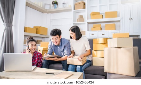 Small business entrepreneur SME freelance man woman work home office concept, Asian small business owner use smartphone online marketing packing box delivery, SME seller e-commerce online team concept