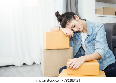 Small business entrepreneur SME freelance asian woman working with box at home concept, Young Asian woman small business owner, online marketing box and delivery, SME bankrupt stress burnout concept
