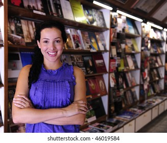 small business: happy owner of a bookstore