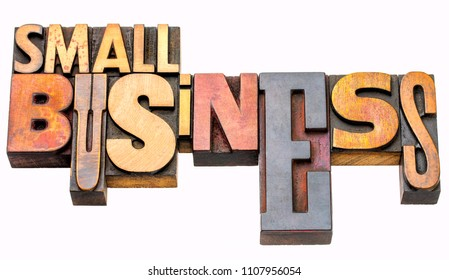small business - isolated word abstract in vintage letterpress prinitng blocks, mixed fonts
