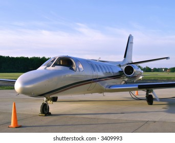 Small business jet sits on the tarmac waiting for its passengers