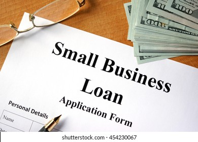Small business loan form on a wooden table.