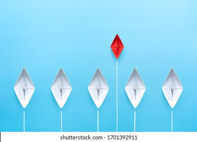Small business, Small and Medium Enterprise concept with small red paper ship on blue background
