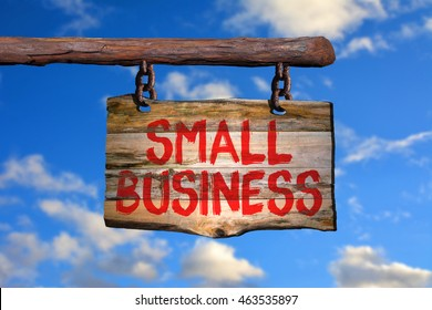 Small business motivational phrase sign on old wood with blurred background