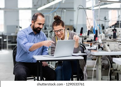 Small business owner and adult woman working in textile factory.