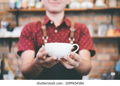 Small Business and Owner Business Concept. Young owner of coffee cafe service customer.