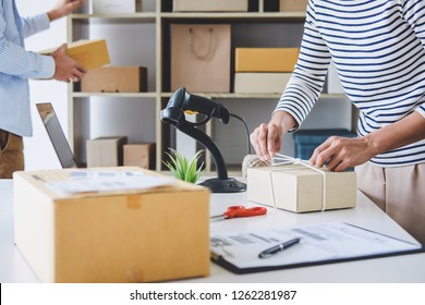 Small business owner delivery service and working packing box, business owner working checking order to confirm before sending customer in post office, Shipment Online Sales.