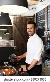 Small business owner making coffee at cafe