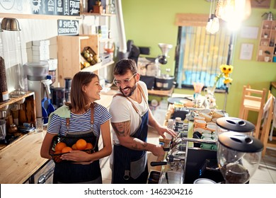 small business owner smiling at workplace with happy employee.