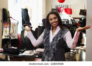 Small business owner standing in clothing shop