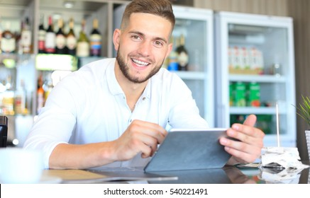 Small business owner working at his cafe