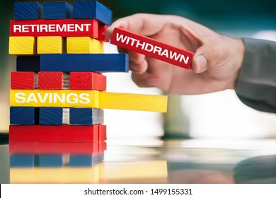 An small business owner's hand; withdrawing money from retirement plan an savings account.