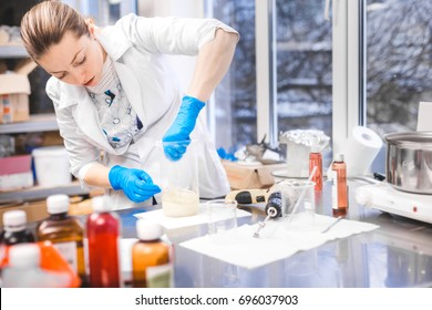 Small business people at work. Young woman working at the laboratory of cosmetic production.