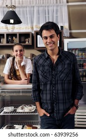 small business portrait: owner of a cafe and waitress