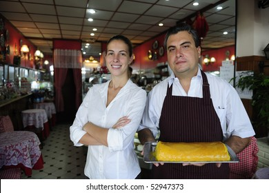small business: proud female owner of a cafe and waiter