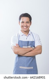 Small business shop owner. Apron man smiling proud and happy isolated on white background. Young entrepreneur asian male