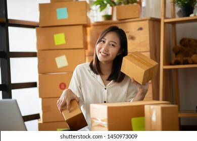 Small Business SME entrepreneur of Young Asian women working with laptop for Online shopping at home,Cheerful and Happy with box for packaging in home,Own Business Start up for Business Online