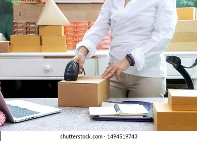 Small business woman Worker delivery service and working packing box, business owner working checking order to confirm before sending customer in post office, Shipment Online Sales