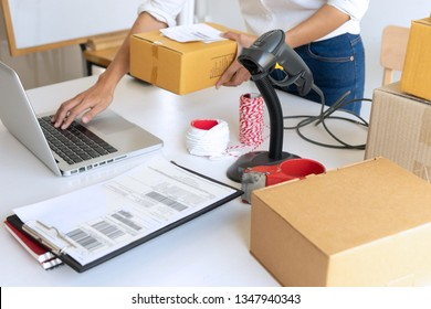 Small business Worker  delivery service and working packing box, business owner working checking order to confirm before sending customer in post office, Shipment Online Sales
