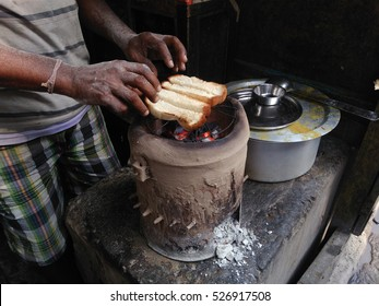 A small businessman baking bread for his customers