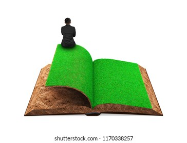 Small businessman sitting on the opened book of green grass and soil textured, isolated on white background, concept of ECO, renewable energy and circular economy.