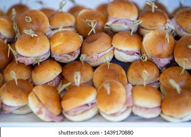 Small buttered sandwiches with ham and cheese