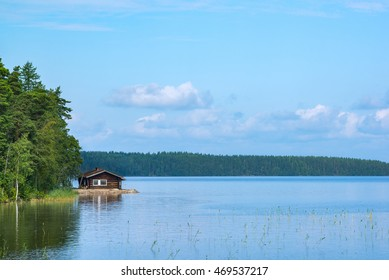 Small cabin in shore of lake in Finland