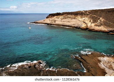 Small cala with boat, transparent waters in La Caleta, Tenerife, Canary Islands, Spain,