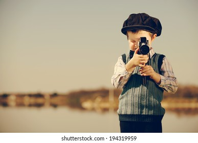 small cameraman captures nature. vintage- look / retro photographer
