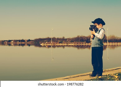 small cameraman captures nature vintage- look / retro videographer