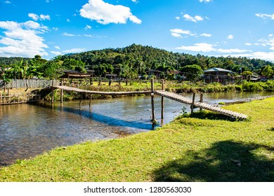 Small canal with mountain in Mueang Khong district, Thailand. - Shutterstock ID 1280563030