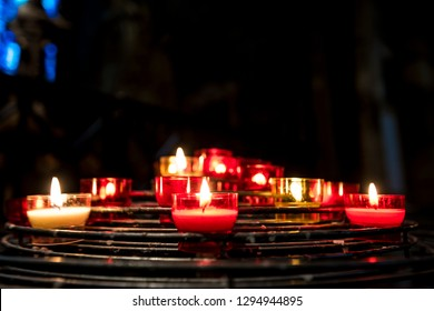 Small candles lit in the interior of the Notre Dame cathedral in Paris