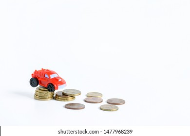 Small car red toy and euro coin on white background. Car loan budjet with saving money, finance and business concept