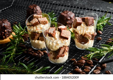 Small caramel-waffle dessert in plastic cups. Top view. Sweet bar.
