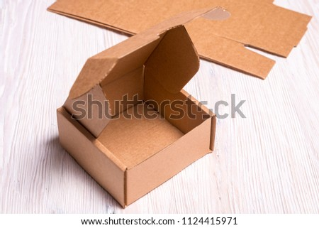 Small Cardboard Box On Wooden Desk Stock Photo Edit Now 1124415971